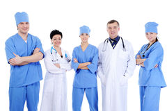 Large group of laughing successful doctors. And surgeons standing together Stock Images