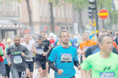 Large group of male runner in the rainy stockholm Stock Images
