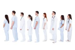 Large group of medical staff standing in a queue Stock Images