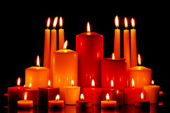 Large group of mixed candles burning royalty free stock image