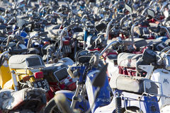 Large group of motorbikes and scooters in Police parking Royalty Free Stock Images
