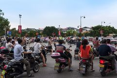 Large group of motorcycles in a traffic jam in a cross road in the city of Guilin in China Stock Photos
