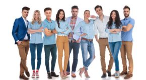 Large group of happy casual men and women standing. Large group of nine happy casual men and women standing on a white background stock photography