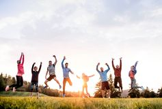Free Large Group Of Fit And Active People Jumping After Doing Exercise In Nature. Royalty Free Stock Images - 164929519