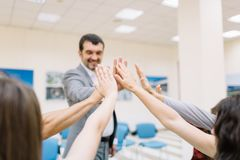 Business partners giving each other a high five on a blurred background. Office unity concept. royalty free stock photo