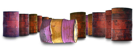 Large group of old rusty oil barrels Stock Photos