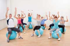 Large group of people doing pilates Stock Image