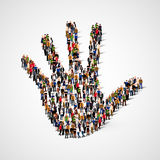 Large group of people in form of hand icon. Care, friendship, support or family concept. Royalty Free Stock Image