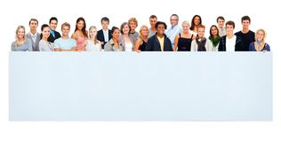 Large group of people holding an empty billboard. Group of mixed aged men and women holding a blank billboard against white stock photo