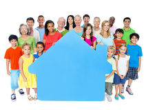 Large Group People Holding Home Symbol Concept Royalty Free Stock Photography