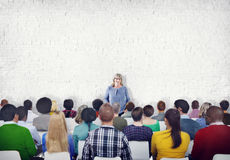 Large Group of People Listening to the Speaker Stock Photo