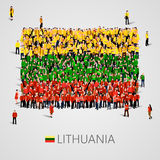 Large group of people in the shape of Latvian flag. Republic of Lithuania. Stock Photo