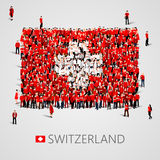 Large group of people in the shape of Swiss flag. Swiss Confederation. Switzerland concept. Royalty Free Stock Photography