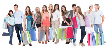 Large group of people with shopping bags. Isolated on white royalty free stock photos