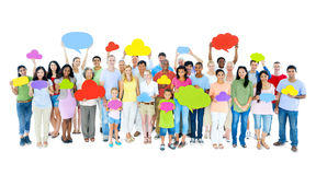 Large Group of People with Speech Bubbles Stock Photos