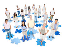 Large Group of People. Standing on jigsaw Royalty Free Stock Images