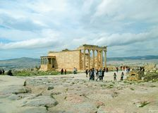 Large Group of People Visiting the Erechtheion Ancient Greek Temple on the Hilltop of Acropolis, Athens, Greece. Europe antique architecture attraction royalty free stock images