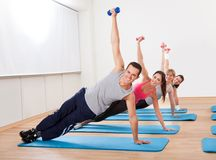 Large group of people working out in a gym Royalty Free Stock Photos
