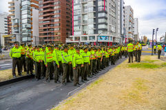 Large group police officers line up formation as Stock Image