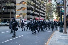 Large group of police officers in riot gear in Portland, Oregon. royalty free stock image