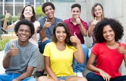Large group of pretty international young adults showing thumb u stock image