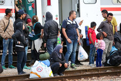 Large group of refugees on railway Stock Photos
