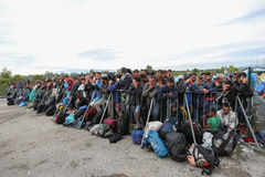 Large group of refugees at slovenian border Stock Photos