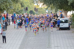 Large group of running girls and boys in blue Royalty Free Stock Photography
