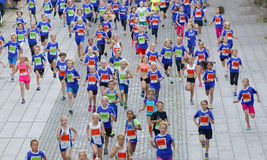 Large group of running girls and boys in blue Stock Photos