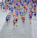 Large group of running girls and boys in blue Stock Photography