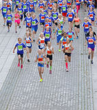 Large group of running girls and boys in blue Stock Images