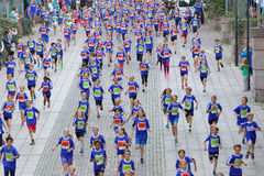 Large group of running girls and boys in blue Stock Photo