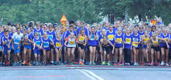 Large group of running girls and boys starting Royalty Free Stock Photos