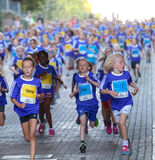 Large group of running girls and boys Stock Photography