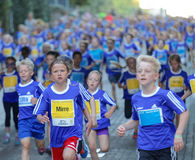 Large group of running girls and boys Stock Image