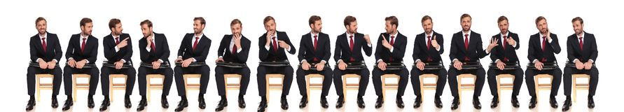 Large group of the same businessman with different reactions stock photography