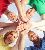 Large group of smiling friends staying together and looking at c. Happy, smiling friends standing together over sky background. Education, college, university Royalty Free Stock Photos