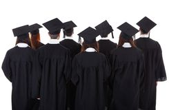 Large group of students graduating. Standing in the gowns and mortarboard hats viewed from behind isolated on white Stock Images