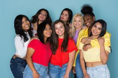 Large Group Of Teens. Large group of teen girls wearing colorful shirts stock photo