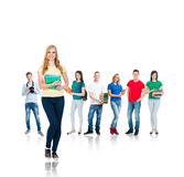 Large group of teenage students isolated on white background. Many different people standing together. School, education, college, university concept Royalty Free Stock Photo