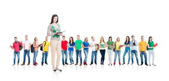 Large group of teenage students isolated on white. Background. Many different people standing together. School, education, college, university concept Stock Image