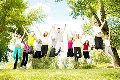 Large group of teens jumping together. Happy large group of teens jumping together, outdoor royalty free stock photo