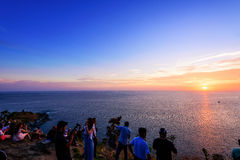 Large group of tourist waiting for the sunset over the sea Stock Photography