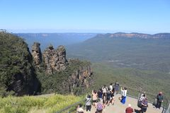 Three sisters blue mountains mass tourism Australia. Large group of tourists taking photos of the Three Sisters in the Blue mountains in Australia royalty free stock photography
