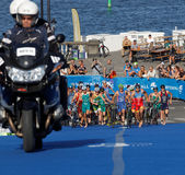 Large group of triathletes running in the transition zone Stock Photography