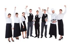 Large group of waiters and waitresses cheering Royalty Free Stock Photos