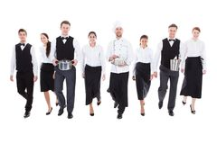 Large group of waiters and waitresses. Isolated on white Royalty Free Stock Images