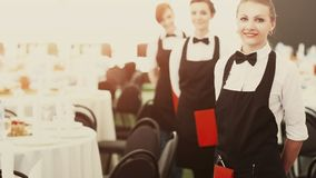 A large group of waiters and waitresses next to served tables. A large group of waiters and waitresses next served tables Stock Photo