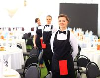 Large group of waiters. And waitresses standing in row Stock Photo