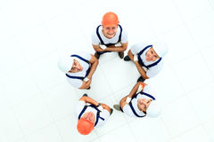 Large group of workers. Standing in circle royalty free stock photography